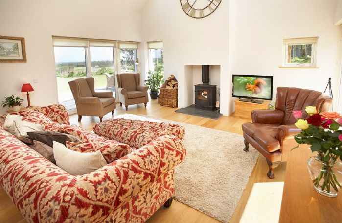 Ground floor:  Double height sitting room with wood-burning stove and stunning views