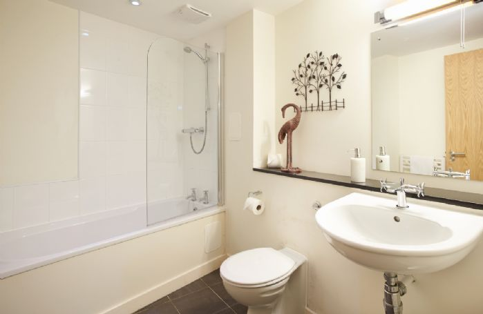 Ground floor:  Family bathroom with bath and shower over the bath