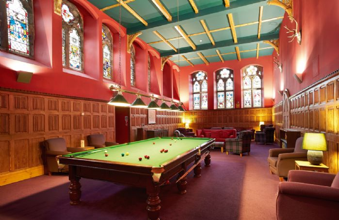 Communal billiards room