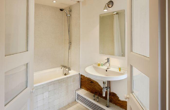 First floor:  En-suite bathroom with shower over bath