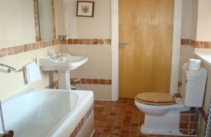 First floor:  Jack and Jill bathroom with bath and shower over giving access to both bedrooms