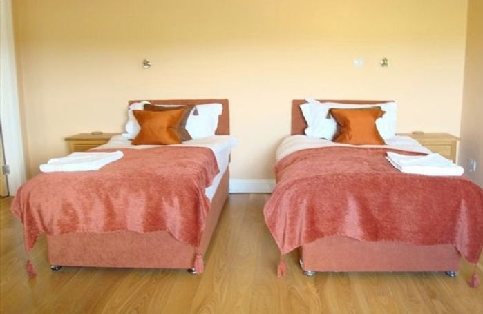 Ground floor:  Double bedroom with zip and link bed (can be made as twins upon request)