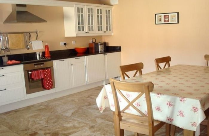 Ground floor: Spacious kitchen dining area with views over the courtyard