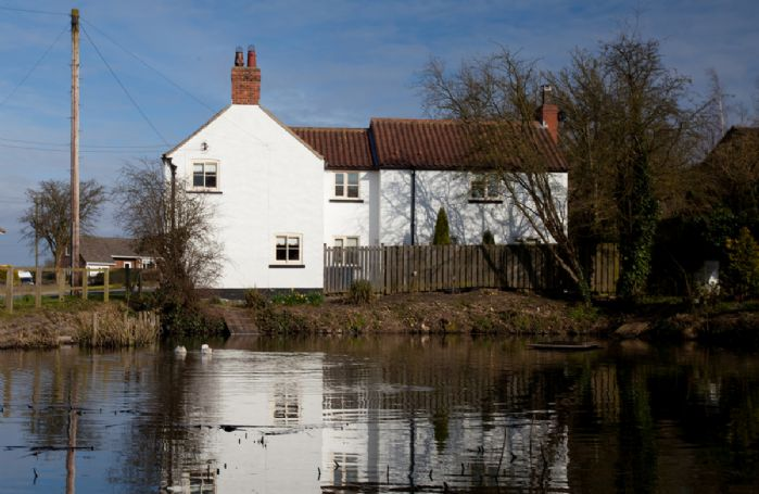 The property overlooks the village pond