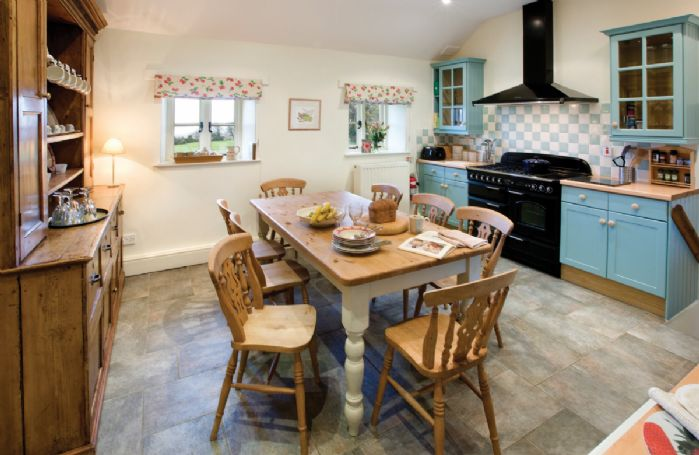 Ground floor: four steps from hallway to kitchen with breakfast table