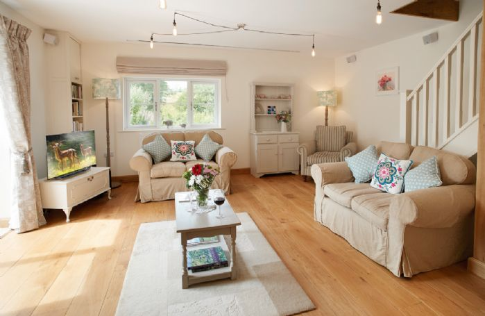 Ground floor: Open plan sitting room with oak flooring