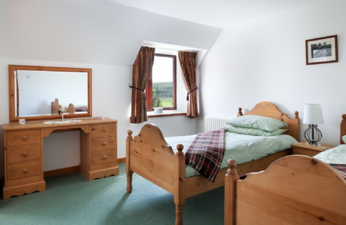 First floor:  Twin bedroom with en-suite bathroom