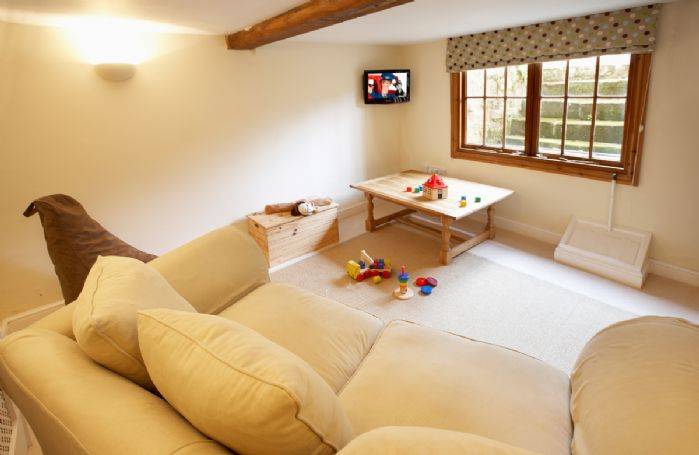 Basement:  Snug/children's play room with large sofa bed for visitors (no charge)