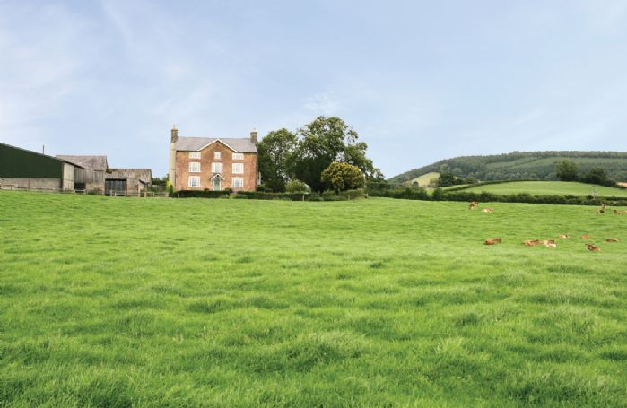 The house is surrounded by its own ancient rolling pasture land