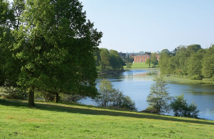 A view across the lake to Staunton Harold Hall