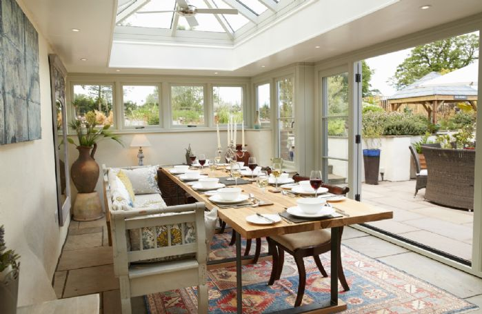 Ground floor: The impressive Orangery brings the outdoors in with large bi-fold doors that open on to the garden and courtyard