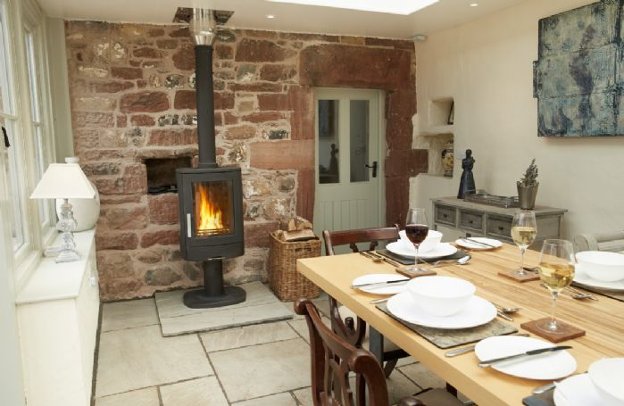 Ground floor: The Orangery with dining table seating 10 and wood burning stove
