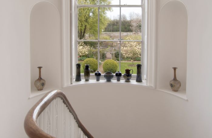 Views from the curved staircase towards the gardens
