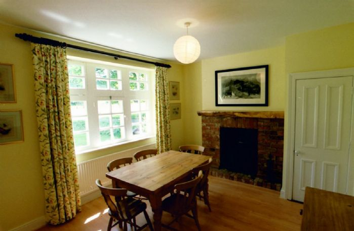Ground floor: Dining room with woodburning stove