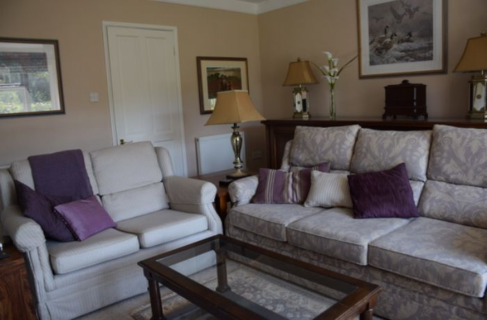 Ground Floor: Spacious sitting room with flat screen tv for enjoyable movie nights in