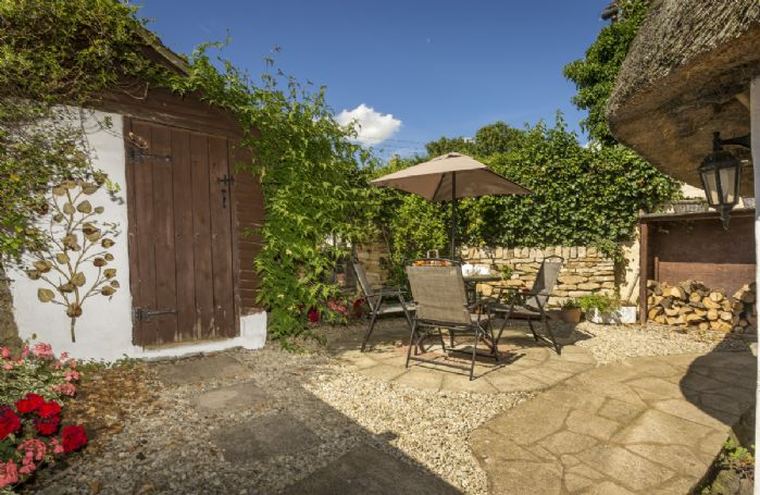Pretty fully enclosed patio garden to the rear