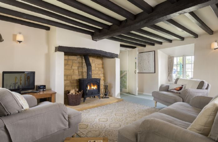Ground floor:  Large sitting room and dining area with inglenook fireplace and window seats