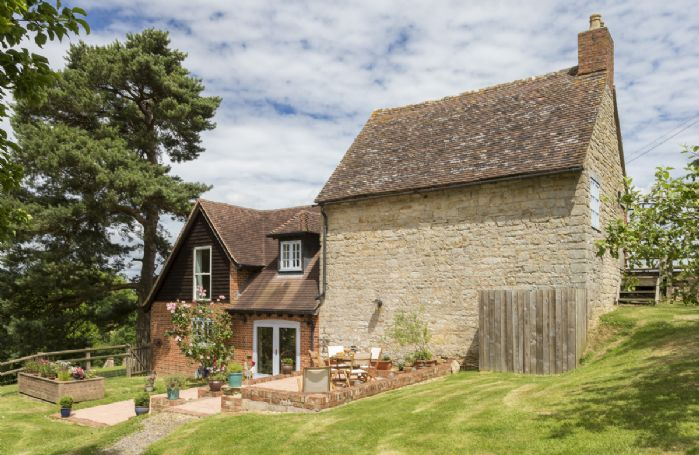 The Granary, located on a working farm, incorporates an original stone barn and offers peaceful seclusion in a very rural position at the end of a half mile private road