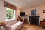Ground floor: Cosy and relaxing sitting room with wood burning stove