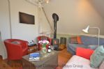 Thumbnail Image - The comfortable living area with a woodburner at the centre