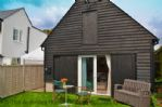 Thumbnail Image - The distinctive black weatherboard of The Sail Loft
