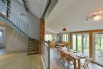 The Dairy: Split level ground floor with open plan kitchen/dining area and tables and chairs