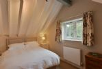 The Dairy: First floor with twin bedroom with 2'6 single beds that can be made up as a 5' king size double bed