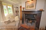 Thumbnail Image - Cosy spot by the fire to curl up with a good book