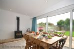 Thumbnail Image - The dining area with woodburning stove and doors leading to the garden