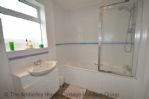 Thumbnail Image - Family bathroom with bath and hand held shower overhead