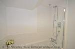 Thumbnail Image - Ground floor bathroom with full bath and shower overhead
