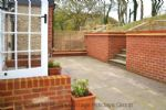 Thumbnail Image - Terrace area with tiered garden and views overlooking the local parish church