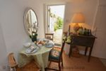 Thumbnail Image - Dining table area with the door to the garden