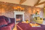 Ground floor: Spacious sitting room with glass doors opening onto  veranda and private garden