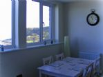 The dining area, with view of Castle Headland in the background..