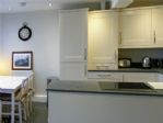 The kitchen and dining area, bright and airy.