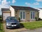 Front of bungalow - private drive - other parking available