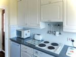 A compact but well-equipped kitchen,......