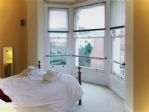 The master bedroom with beautiful views of Oliver's Mount.