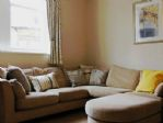 This apartment is designed for relaxation - Lounge with large, soft corner settee.