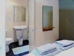 Adjacent to this room, is an en suite bathroom.