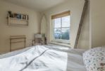 First floor: Double bedroom with views into town