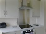 Kitchen - ceramic hob, oven, extractor and lots of cupboards.