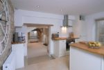 Ground floor:  Kitchen leading through to dining area and sitting room