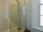 1st floor bathroom. Small bath, shower and screen.