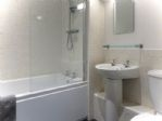 .. with bath, overhead shower and glass screen ...
