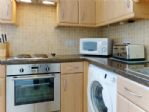 .. electric oven, hob, extractor, microwave and toaster.