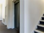 .. into a welcoming communal area with lift and stairs ...