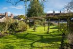 Large garden including a terrace, orchard, small pond and garden furniture