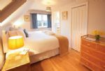 First floor: Double bedroom with 6' bed with en-suite bathroom